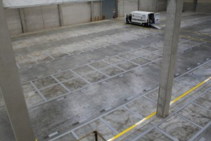 Oberflächenschonende Demarkierung durch überspritzen mit einer 2K-Farbe Betongrau Continental in Korbach